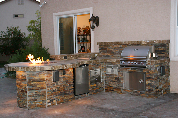 Custom Outdoor Kitchen Design with Social Area and Fire